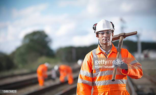 railway worker holding tool - railroad stock pictures, royalty-free photos & images