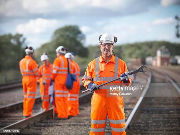 Railway worker holding tool