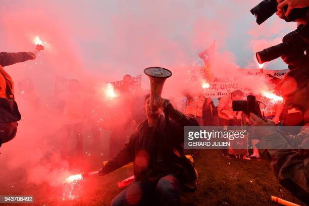 TOPSHOT SNCF railway workers demonstrate on April 9 2018 in Paris as part of their strike over plans to overhaul the national stateowned railway...