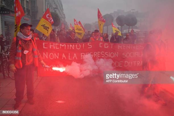 Railway workers march a demonstration called by the CGT workers' union against the French president's labour law reforms on October 19 2017 in Rennes...