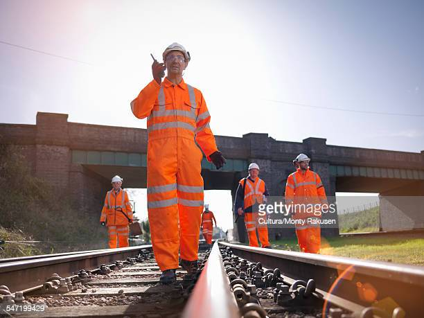 railway workers on railway track - railroad stock pictures, royalty-free photos & images
