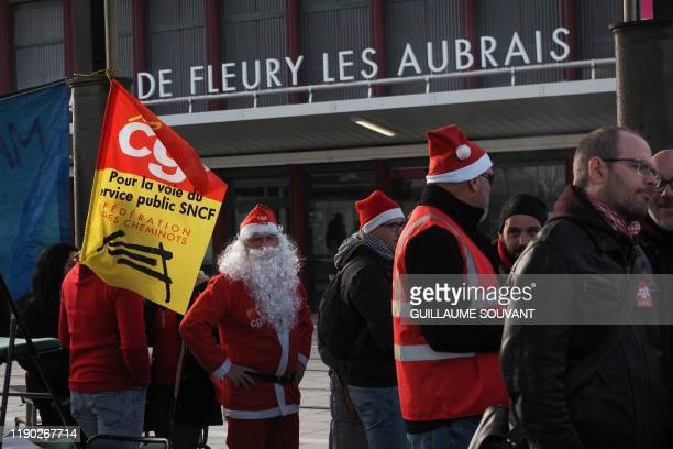 SNCF railway workers organize a Christmas banquet in front of the Les Aubrais station after a meeting against the French government's pension reform...