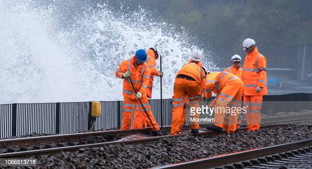 railway workers repairing train line storm damage at dawlish - rail transportation stock pictures, royalty-free photos & images