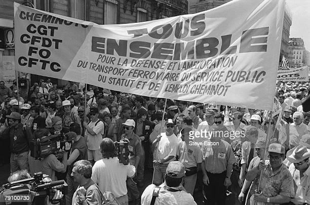 Railway workers take part in a demonstration by the French union federations the CGT FO and SUD protesting at the planned privatisation of the French...