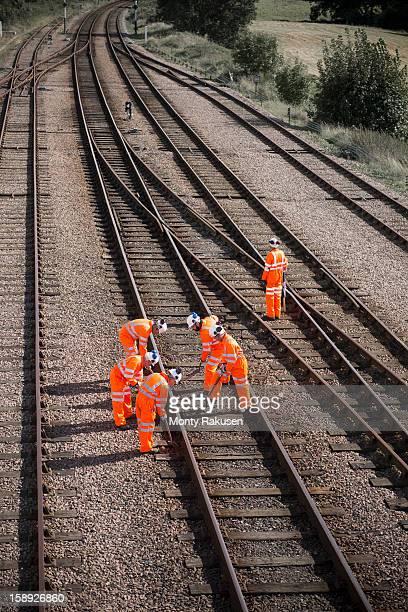 Railway workers working on railway tracks