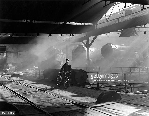 A railwayman crossing the turntable at York locomotive depot at the end of his shift Photograph by Bishop Eric Treacy