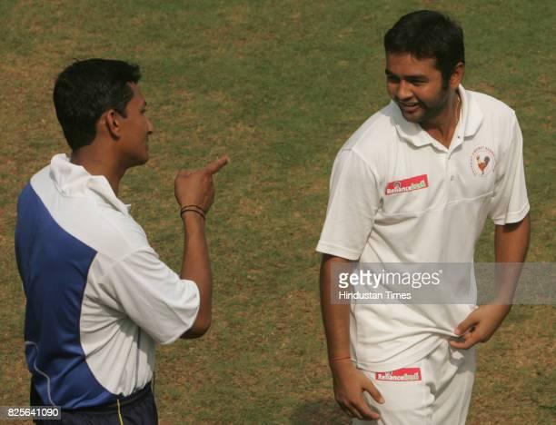 Railways bowler Sanjay Bangar having some words with Gujarat's captain Parthiv Patel after Gujarat won the Ranji Trophy Plate Div final match between...