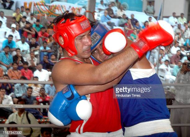 Railway's boxer Paramjeet in action against Mehar of Jharkhand during the final of the 54th Senior National Boxing Championship at Karnail Singh...