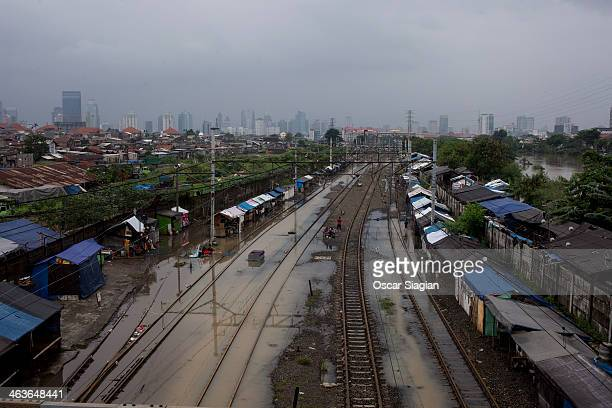 Railways hits by flood seen on January 18 2014 in Jakarta Indonesia Over 10 000 people have been evacuated from Jakarta as rain has battered the...