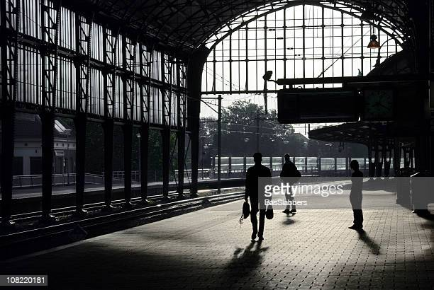 railways; silhouette of people walking on train station platform - basslabbers, bastiaan slabbers stock pictures, royalty-free photos & images