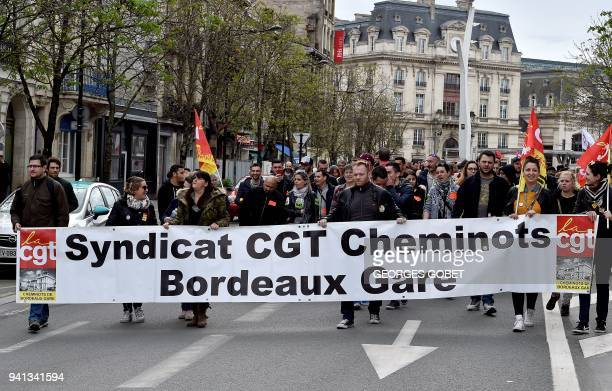 Railways workers memebrs of a CGT trade union attend a protest rally in Bordeaux southwestern France on April 3 at the start of three months of...