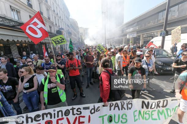 SNCF railworkers take part in a demonstration on April 19 2018 in Paris as part of a multi branch day of protest called by French unions CGT and...