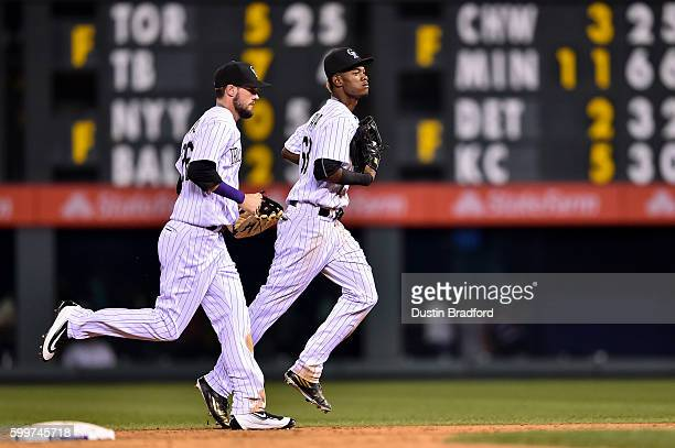 Raimel Tapia and David Dahl of the Colorado Rockies run off the field after playing defense in the ninth inning of a game at Coors Field on September...