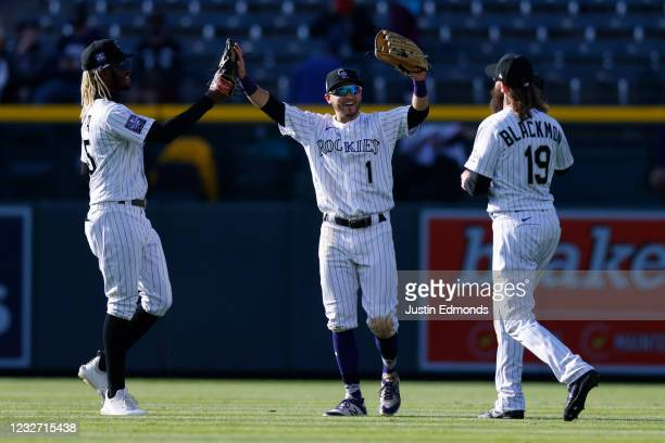 Raimel Tapia, Garrett Hampson and Charlie Blackmon of the Colorado Rockies celebrate their 6-5 win against the San Francisco Giants at Coors Field on...