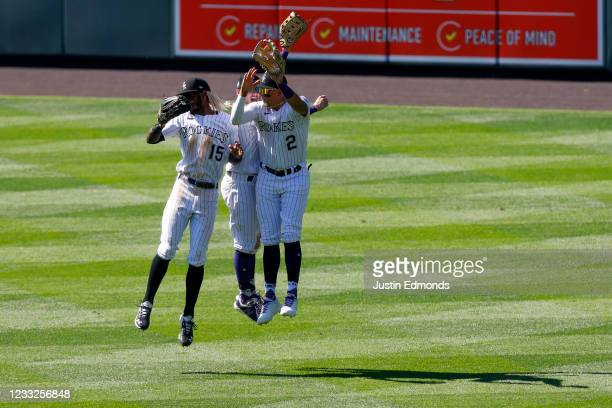 Raimel Tapia, Garrett Hampson and Yonathan Daza of the Colorado Rockies celebrate their 11-6 win against the Texas Rangers at Coors Field on June 3,...