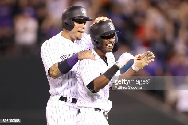 Raimel Tapia of the Coloarado Rockies is congratulated by Carlos Gonzalez after batting in the winning run in the bottom of the ninth inning against...