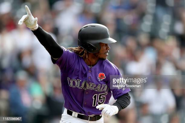 Raimel Tapia of the Colorado Rockies celebrates hitting a walk off single to drive in the wining run in the 11th inning against the Arizona...