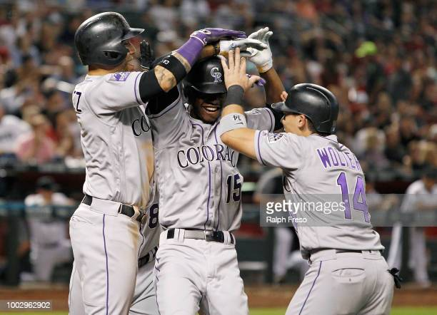 Raimel Tapia of the Colorado Rockies celebrates with teammates Carlos Gonzalez Gerardo Parra and Tony Wolters after hitting a grand slam home run...