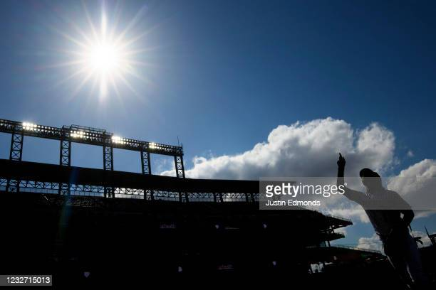 Raimel Tapia of the Colorado Rockies points to the sky as he runs off the field during the sixth inning against the San Francisco Giants at Coors...