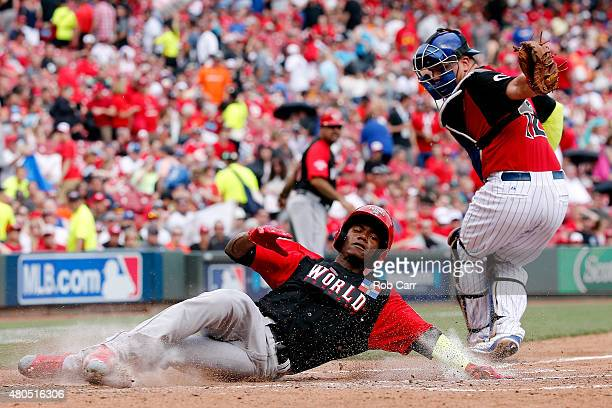 Raimel Tapia of the World Team slides safe to score a run in the third inning against the U.S. Team during the SiriusXM All-Star Futures Game at the...
