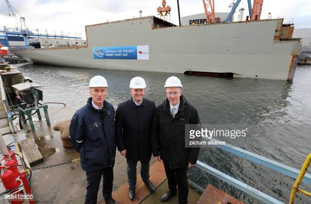 Raimon Strunck CEO of the Neptun Dockyard Christian Pegel Minister of Energy Infrastructure and Digitalization in MecklenburgWestern Pomerania and...