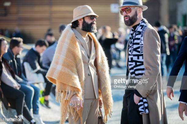 Raimondo Rossi and a guest are seen wearing bucket hat, beige suit, scarf during Pitti Uomo 97 at Fortezza Da Basso on January 08, 2020 in Florence,...