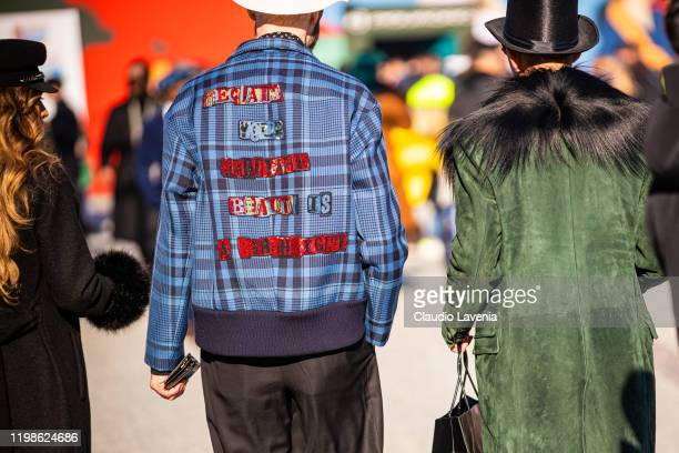 Raimondo Rossi and a guest jacket details, are seen at Fortezza Da Basso on January 09, 2020 in Florence, Italy.