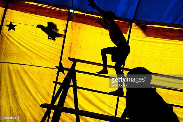 Raimundo a nine years old acrobat chases a chicken at the Circo Anny a familyrun circus wandering the Amazon region of Ecuador on July 04 2010 in...