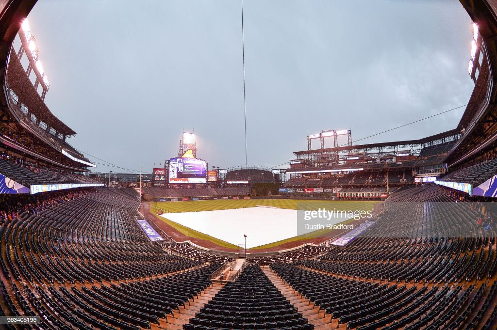 Rain and hail cause a weather delay before the start of a game between the Colorado Rockies and the San Francisco Giants at Coors Field on May 28, 2018 in Denver, Colorado.