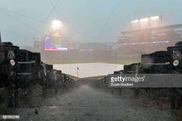 Rain and hail falls on the field during a weather delay before a scheduled game between the Colorado Rockies and the Miami Marlins at Coors Field on...
