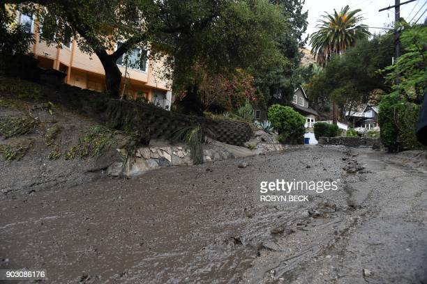 Rain and mud flow out of an neighborhood under mandatory evacuation in Burbank California January 9 2018 Mudslides unleashed by a ferocious storm...