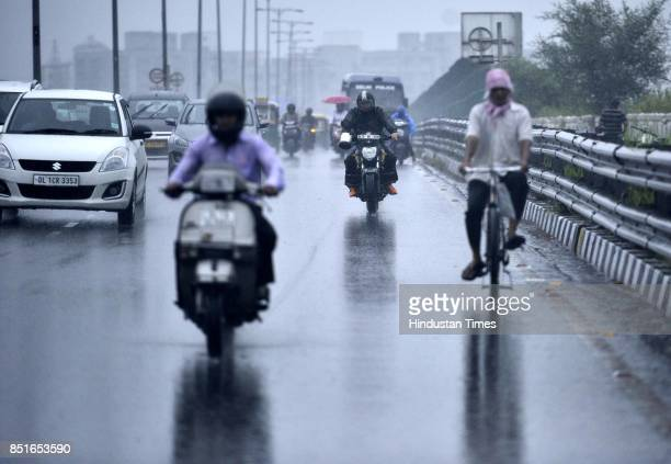 Rain and thundershowers lash many parts of the city bringing some respite from the hot and muggy weather on September 22 2017 in New Delhi India...