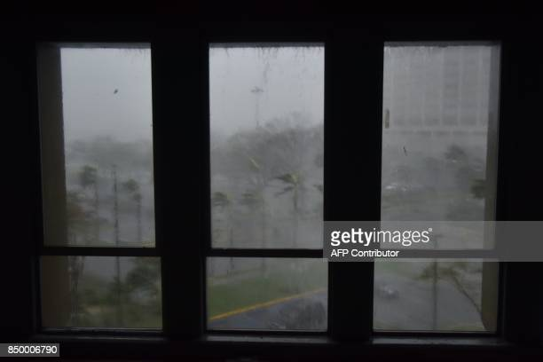 TOPSHOT Rain and wind hit a parking lot at Roberto Clemente Coliseum in San Juan Puerto Rico on September 20 during the passage of the Hurricane...