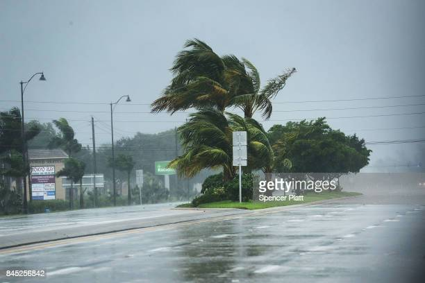 Rain and wind sweep over empty roads as Hurricane Irma arrives into southwest Florida on September 10 2017 in Bonita Springs Florida With businesses...