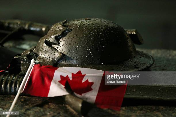 Rain beads on the helmet on the Tomb of the Unknown Soldier Preparations are under way War Memorial on the eve of Remembrance Day