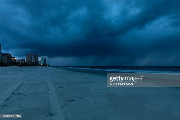 Rain begins to fall as the outer bands of Hurricane Florence make landfall in Myrtle Beach, South Carolina on September 13, 2018. - Hurricane...