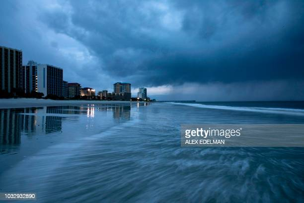 TOPSHOT Rain begins to fall as the outer bands of Hurricane Florence make landfall in Myrtle Beach South Carolina on September 13 2018 Hurricane...