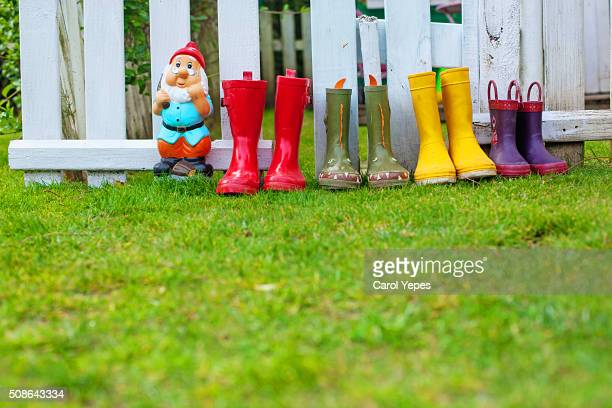 rain boots in a row on lawn