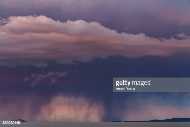Rain cloud at sunset over the lake