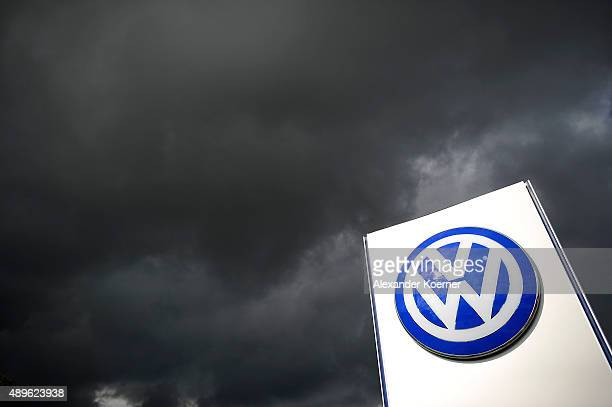 Rain clouds are seen over a Volkswagen symbol at the main entrance gate at Volkswagen production plant on September 23, 2015 in Wolfsburg, Germany....