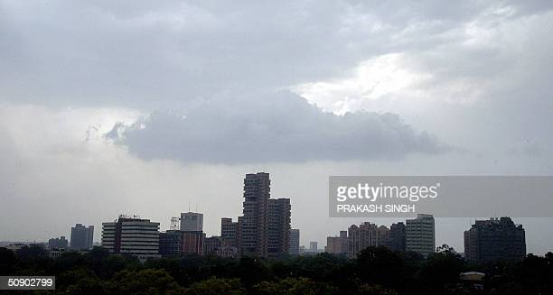 Rain clouds gather above the skyline of New Delhi 27 May 2004 Thunder squalls and rain in the Indian capital has provided the muchneeded relief from...