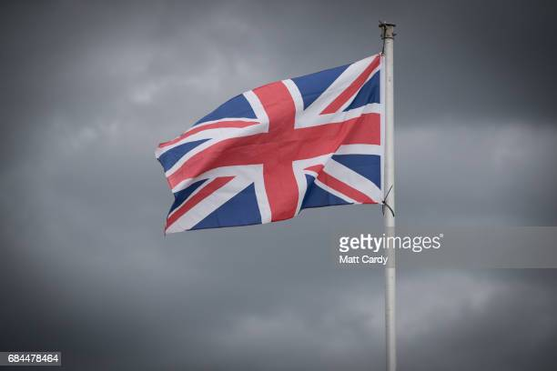 Rain clouds gather behind a Union Jack flag at the 122nd Devon County Show at the Westpoint Arena and Showground in Clyst St Mary near Exeter on May...
