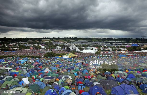 Rain clouds gather over the Pyramid Stage at the Glastonbury Festival site at Worthy Farm, Pilton on June 24, 2011 in Glastonbury, England. Music...