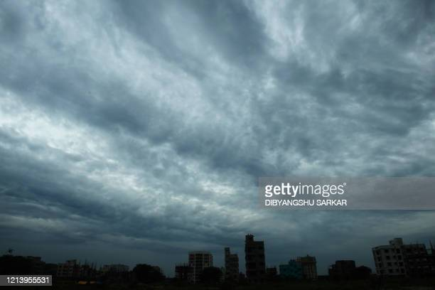 Rain clouds loom over a Kolkata on May 19 as Cyclone Amphane barrels towards India's eastern coast Millions of people were being moved to safety on...