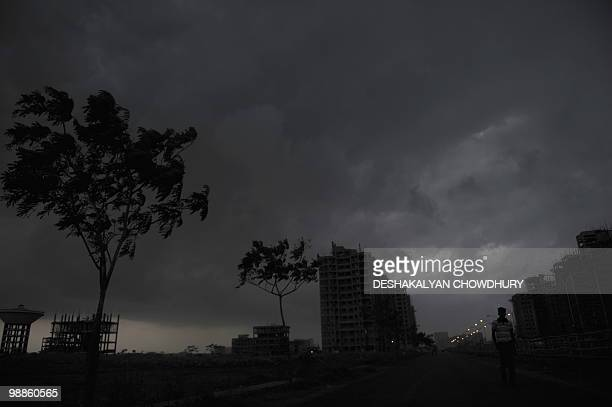 Rain clouds move in over the skyline of Kolkata on May 5 2010 Monsoon rains brought relief as summers temperatures soared above 40 degrees Celsius...