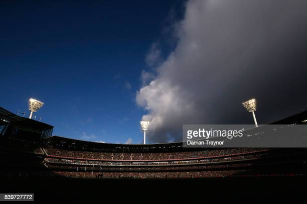 Rain clouds move over the MCG during the round 23 AFL match between the Richmond Tigers and the St Kilda Saints at Melbourne Cricket Ground on August...