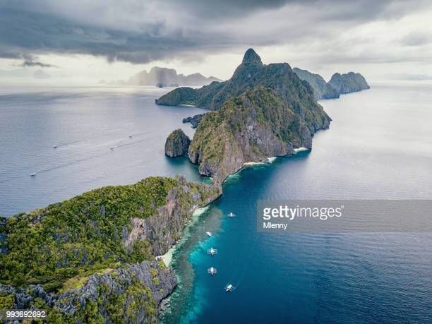 rain clouds over el nido matinloc island palawan aerial view - el nido stock pictures, royalty-free photos & images