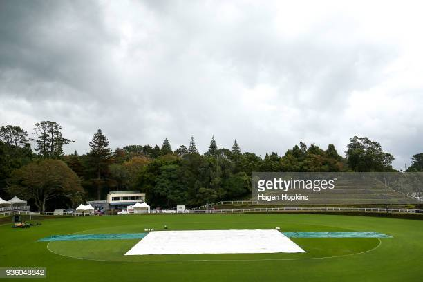 Rain covers protect the wicket as play is abandoned during the fourth women's Twenty20 International between the New Zealand White Ferns and West...