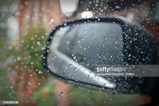 rain drop on the window and a glass outside the car in the raining day. - aungsumol stock pictures, royalty-free photos & images