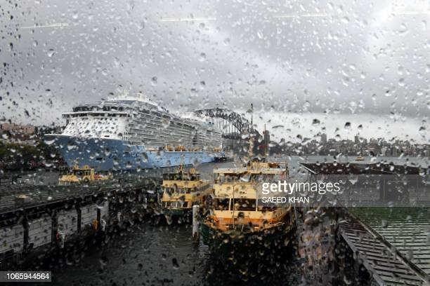TOPSHOT Rain droplets are seen on the window of the Circular Quay train station as clouds cover the Sydney Harbour on November 28 2018 Flights were...